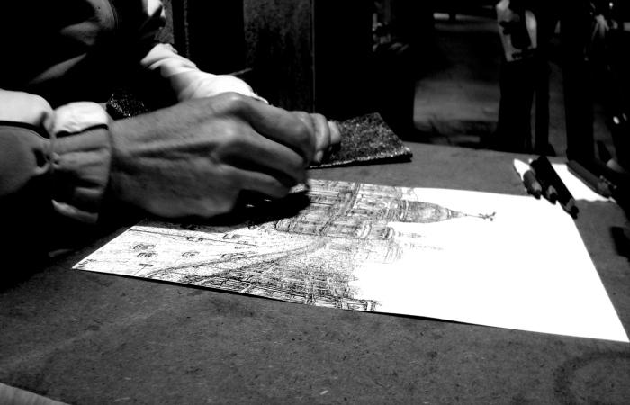 Dibujo de pintor callejero en Madrid