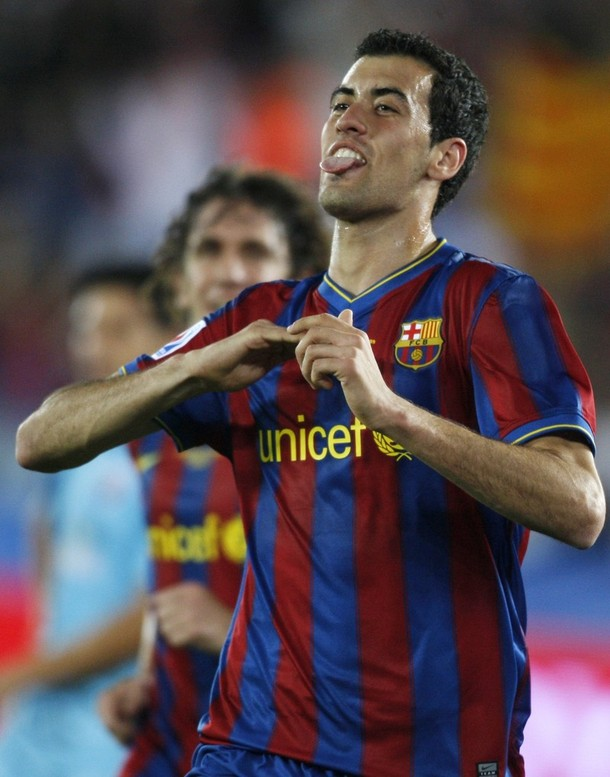 Barcelona's Busquets celebrates his goal during their FIFA Club World Cup semi-final soccer match against Atlante in Abu Dhabi